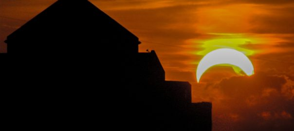 View of Solar Eclipse and Building in Silhouette